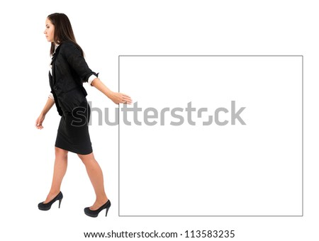Isolated young business woman pull something - stock photo