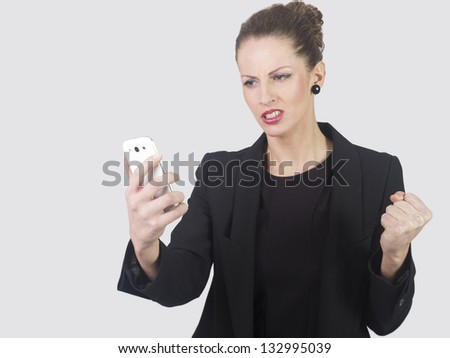 Isolated young business woman screaming at phone - stock photo