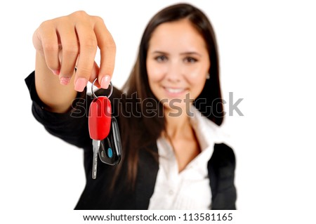 Isolated young business woman showing car key - stock photo