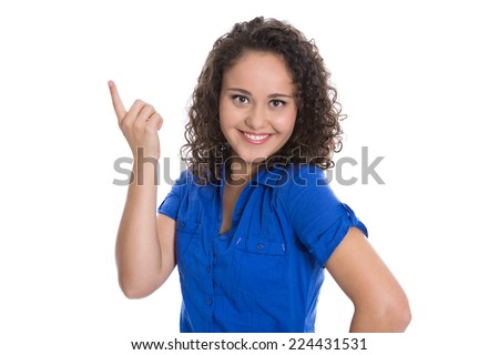 Isolated young business woman showing something with her finger wearing blue blouse. - stock photo
