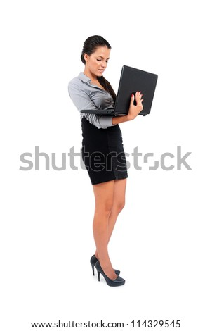 Isolated young business woman using laptop - stock photo