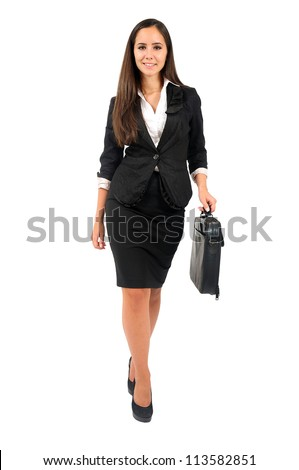 Isolated young business woman walking - stock photo