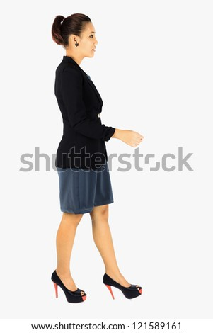 Isolated Young  Business woman walking on white - stock photo