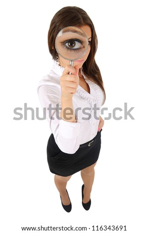 Isolated young business woman with magnifier - stock photo
