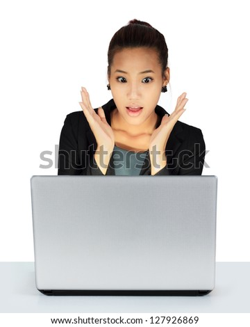 Isolated young business woman working on a table - stock photo