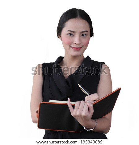 Isolated young business woman write something with her book over white background - stock photo