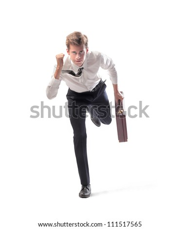 Isolated young businessman running fast
