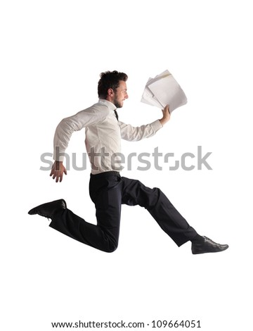 Isolated young businessman running with some documents in his hand - stock photo