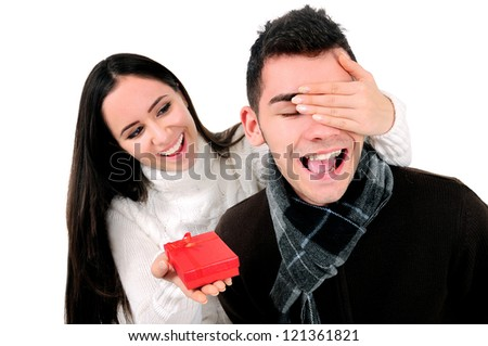 Isolated young casual couple with gift - stock photo