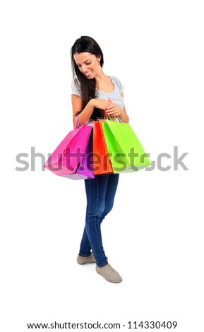 Isolated young casual woman with shopping bag - stock photo