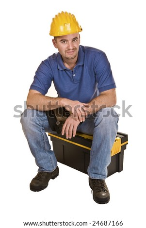 isolated young caucasian man tool sit on toolbox