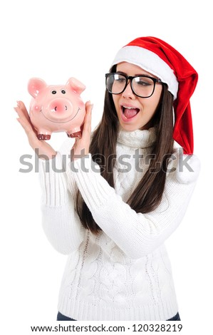 Isolated Young Christmas Girl Holding Piggy Bank - stock photo