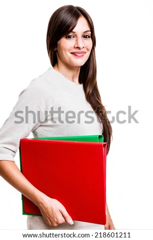 Isolated young female student smiling