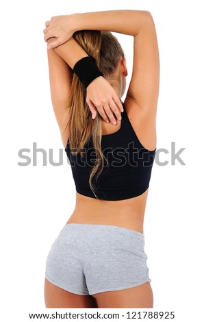 Isolated young fitness woman back view