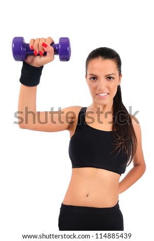 Isolated young fitness woman with dumbbell