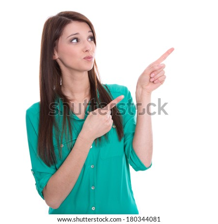 Isolated young funny woman is presenting or pointing with her finger - stock photo