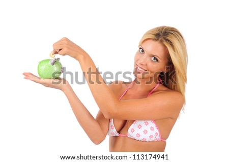 Isolated Young Girl In Swimming Suit With Piggy-Bank