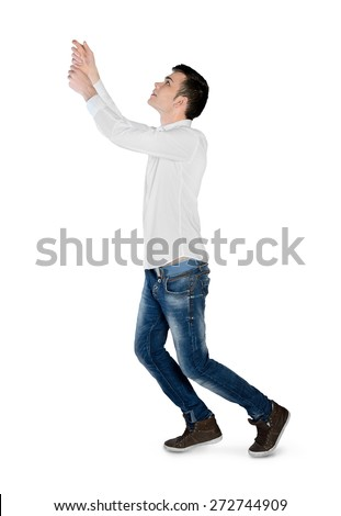 Isolated young man drag something