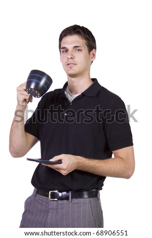 Isolated Young man drinking a cup of coffee - stock photo