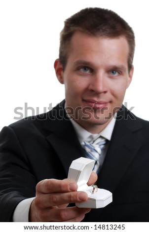 Isolated young man presenting engagement ring on a white background - stock photo