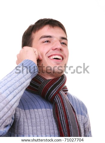 isolated young man smiling talking on the phone - stock photo