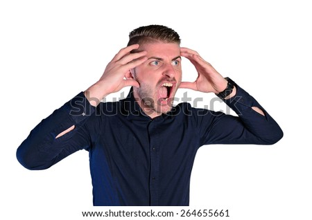 isolated young nervous man screaming - stock photo