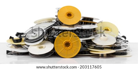 Isolates of VHS tape is not used to bring together a pile of clutter  - stock photo