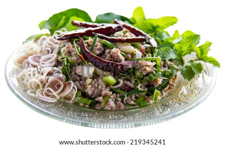 Isolates spicy minced pork with lemongrass and mint leaves to eat healthy. - stock photo