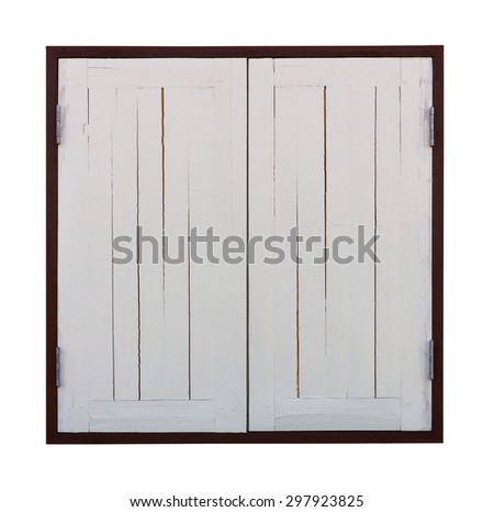 Isolates two old wooden windows painted white in a closed, dark brown frame. - stock photo