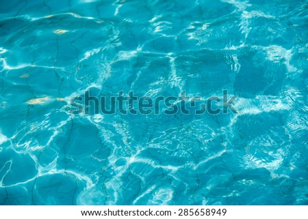 isolation Azure water outdoor swimming pool with reflections of sunlight