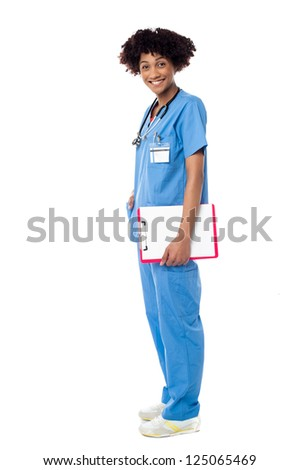 Isolation of a medical practitioner posing sideways with a blank clipboard.