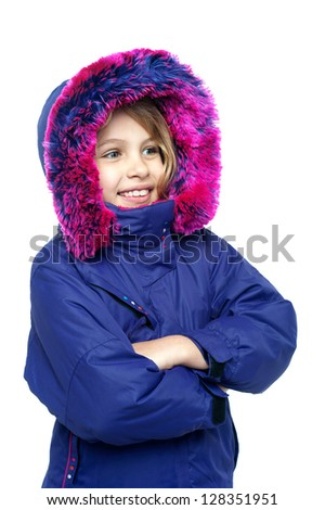 Isolation of a pretty kid in purple jacket standing sideways with her arms crossed. - stock photo