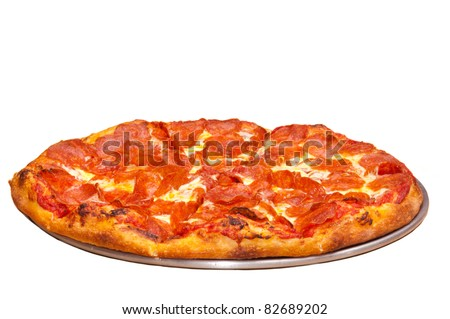 isolation of a whole Pepperoni pizza on a pan - stock photo
