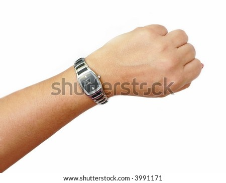 Isolation of woman's wristwatch on wearer. The time is just before 9 o'clock, implying that it's time to get to work. The watch is sport or casual in design. It is black with silver accents.