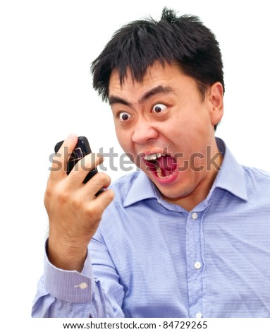 Isolation photo of a crazy angry asian man yelling at his cellphone - stock photo