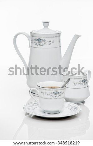 isoleted cup of capuchino with teapot - stock photo