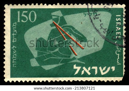 """ISRAEL - CIRCA 1956: a stamp printed in Israel, honor of Jewish Festival """"Shlosha Regalim"""" showing musician with double oboe, biblical times, series, circa 1956 - stock photo"""