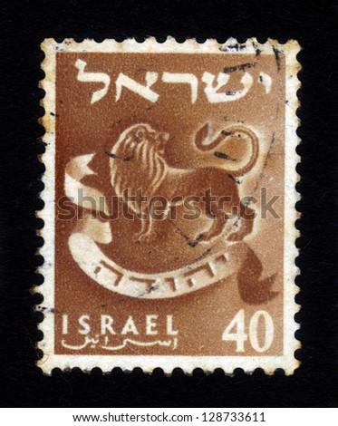 ISRAEL - CIRCA 1956: A stamp printed in Israel honoring twelve tribes of Israel shows Judah - lion's whelp, series emblems of the twelve tribes of Israel, circa 1956 - stock photo