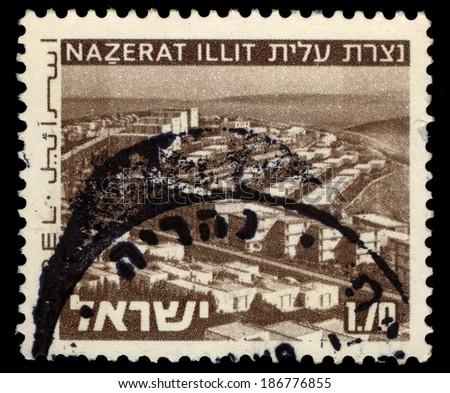 ISRAEL - CIRCA 1975: A stamp printed in Israel shows Nazareth Illit City with inscription Nazerat Illit, circa 1975 - stock photo