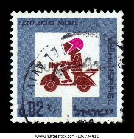 ISRAEL - CIRCA 1966: A stamp printed in Israel shows symbolic image motorcyclist, with the inscription wear a crash helmet, series road safety, circa 1966