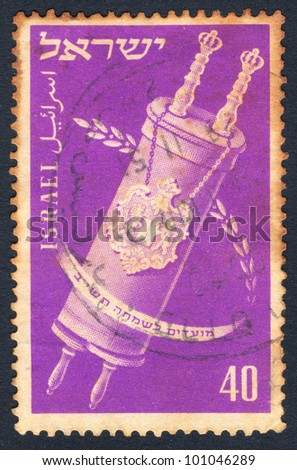 """ISRAEL - CIRCA 1951: An Israeli postage stamp of the series """"Joyous Festivals 1951"""", showing an image of the Torah Scroll with inscription in Hebrew, Arabic and English """"Israel""""; series, circa 1951 - stock photo"""