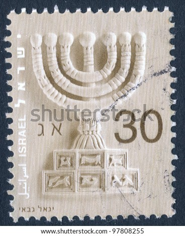 """ISRAEL - CIRCA 2002: An used Israeli postage stamp showing seven branched menorah with inscription in Hebrew, Arabic and English """"Israel""""; series, circa 2002 - stock photo"""