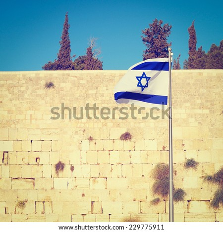 Israel Flag Against  Western Wall in Jerusalem, Israel, Instagram Effect    - stock photo