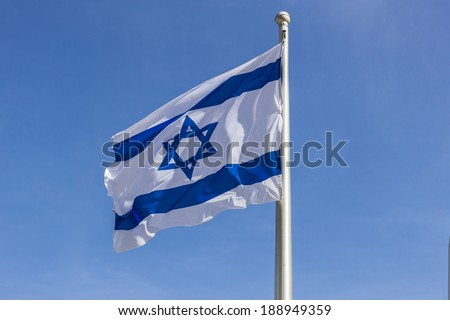 Israel flag in the wind isolated against the sky