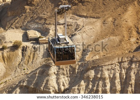 ISRAEL, MASADA - OCTOBER 27, 2014: Cable car to ruins of Masada ancient fortress - one of the most visited place in places in country. - stock photo