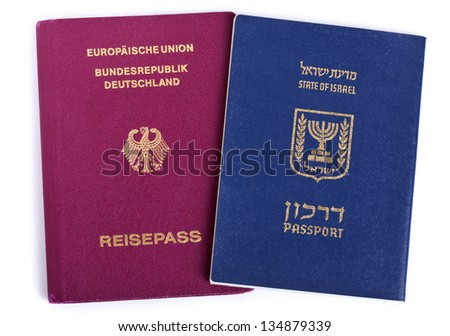 Israeli and German passports isolated on white background. - stock photo