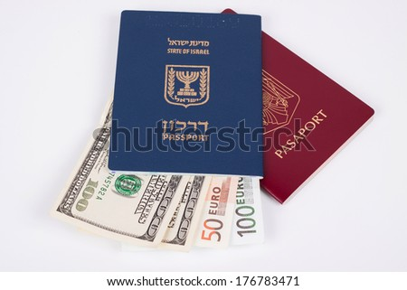 Israeli and Romanian passports with dollar and euro banknotes isolated on white - stock photo