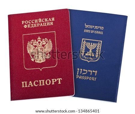 Israeli and Russian passports isolated on white background. - stock photo