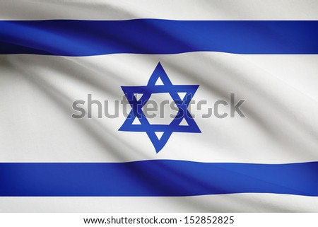 Israeli flag blowing in the wind. Part of a series. - stock photo