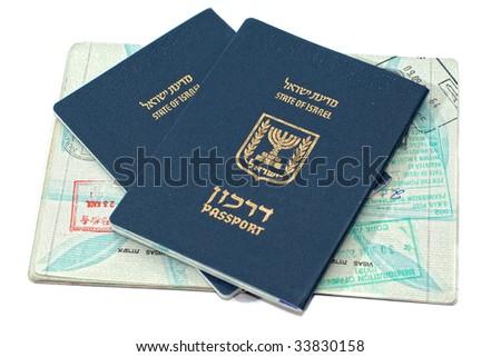 Israeli passports passport sitting on an open passport with passport stamps - stock photo